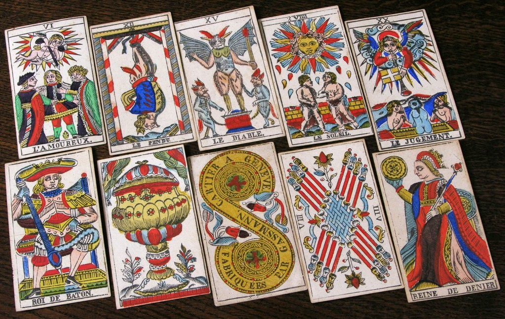 Top: A selection of trump cards (top row) and pip cards (bottom row) from the first edition of the Rider-Waite deck, circa 1909. Via the World of Playing Cards. Photo courtesy Bill Wolf. Above: Cards from a Tarot de Marseille deck made by François Gassmann, circa 1870. Photo courtesy Bill Wolf.