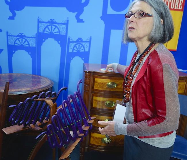 Karen Keane, CEO of Skinner Auctions, tells us about the double music stand by Modernist designer Art Carpenter adorned with purple snakes slashed with green paint.