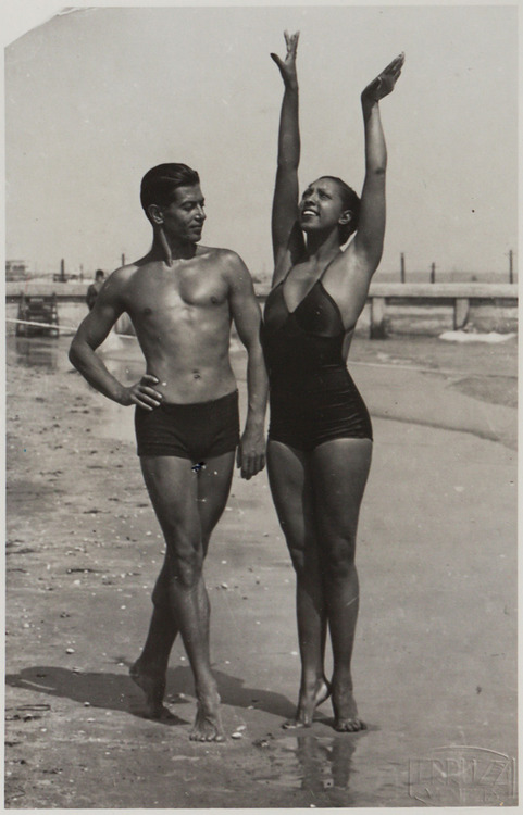 "Josephine Baker, known as the ""Ebony Venus,"" and Russian-born French ballet star Serge Lifar, the ""Bronze Apollo,"" dance on the Lido beach in Venice, Italy in the 1930s. (Via Hotel des Ventes, Geneve)"