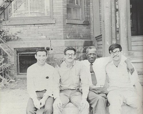 "In the 1960s, members of the ""Blues Mafia,"" including Yazoo Records founder Nick Perls (far left), Dick Waterman, and Phil Spiro (far right), went looking for country blues singers like Son House (second from the right). They persuaded House to revive his career. (Photo by Mrs. House, using Dick Waterman's camera, via <a href=""http://www.wirz.de/music/bg_npfrm.htm"">Wirz.de</a>)"
