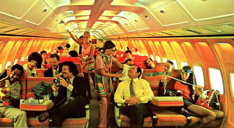These fliers sure look like they're having fun in this early 1970s Braniff International Airways photo, featuring stewardess in Pucci uniforms. (Via TheFoxIsBlack.com)