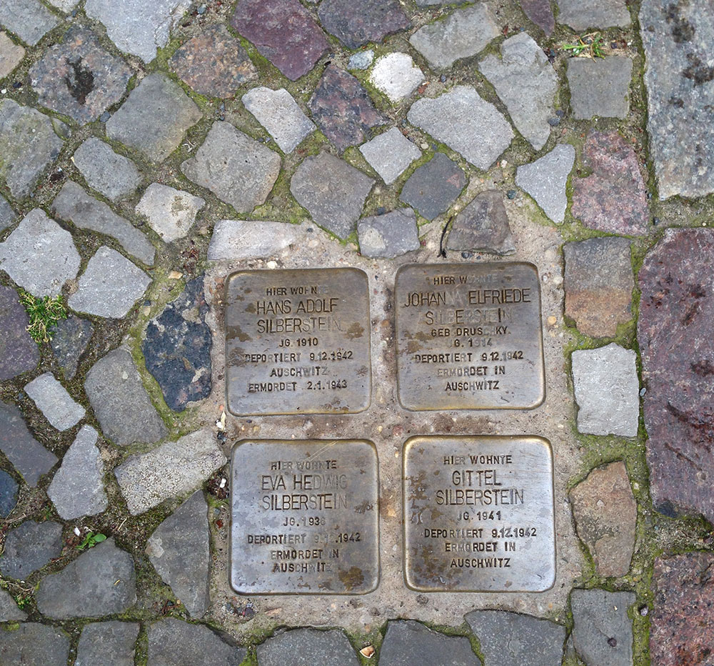 Stolpersteine marking the home of a family of four, all murdered in Auschwitz.