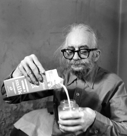 "Famous eccentric 78 collector Harry Smith compiled the first 78 reissue on vinyl, 1952's ""Anthology of American Folk Music."" Here, he pours milk in New York City in 1985. (Photo by Allen Ginsberg, courtesy of the Allen Ginsberg Trust, from ""Do Not Sell at Any Price"")"