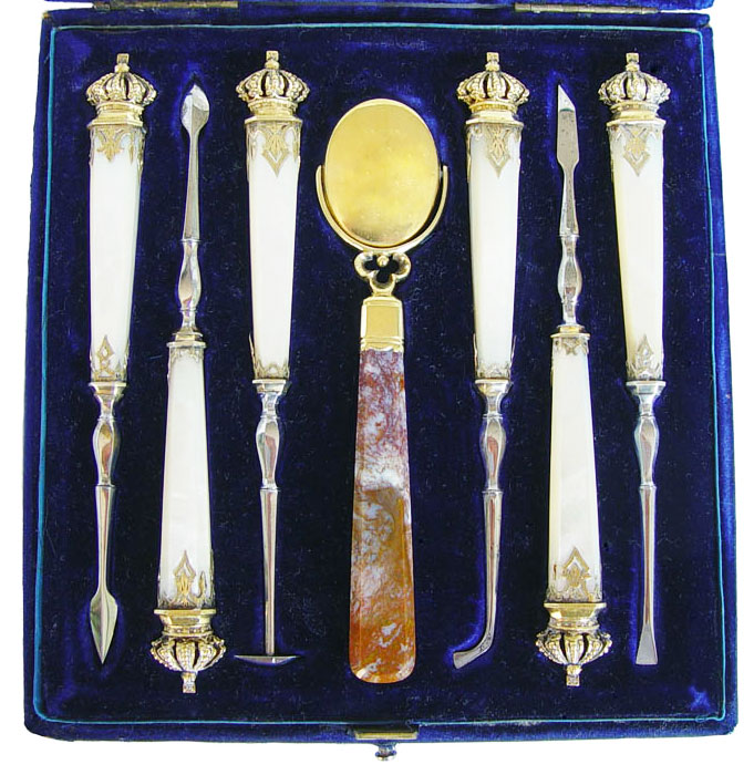 This set of dental scalers was designed for Prince Albert in the 1840s, and matches Queen Victoria's set with mother-of-pearl handles and gold fittings.