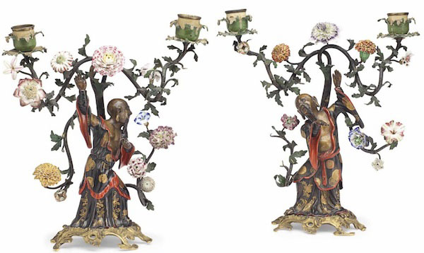 This pair of Louis XV twin-light candelabra is made of porcelain-mounted, patinated, and polychrome-decorated vernis martin, bronze, and ormolu. Attributed to Frères circa 1750, they sold for $245,000. (Christies.com)