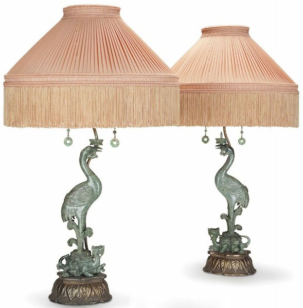 A pair of cranes standing atop mythical Chinese beasts carved into hardstone and mounted onto lamps sold for $10,625. (Via Christies.com)