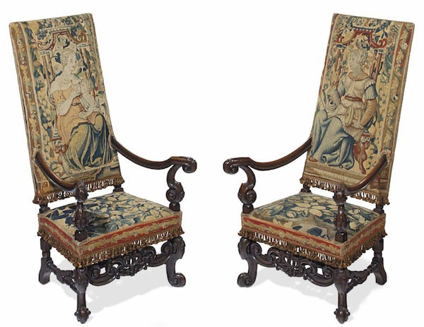 A 19th-century set of French walnut armchairs have backs and seats are covered in 16th-century Flemish tapestry border fragments. (Via Christies.com)