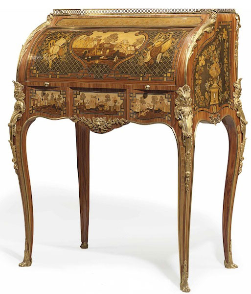 A 1990s copy of Anna La Chapelle's French bureau à cylindre with ormolu-mounted tulipwood, sycamore, and stained fruitwood marquetry and parquetry. (Via Christies.com)