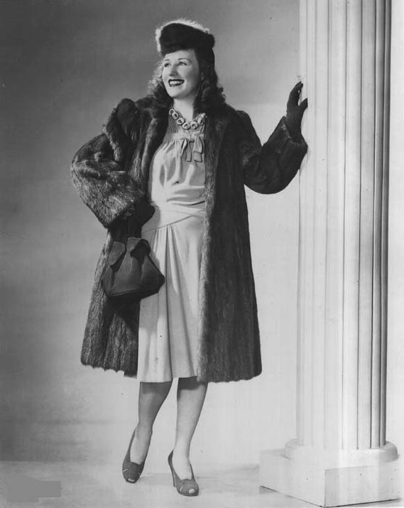 "Dale Messick wears fabulous 1940s fashion in a publicity shot. Despite her success, she always felt left out of the boys club of male cartoonists. (Via ""Pretty in Ink"")"