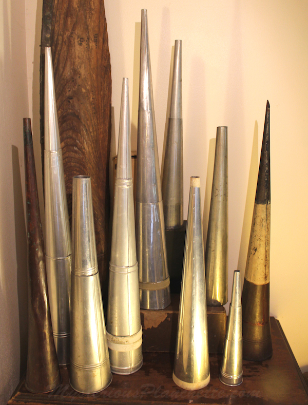 Brandon Hodge has built an impressive collection of spirit trumpets. He found one dismantled in a wheelbarrow outside an antiques shop. (Courtesy of MysteriousPlanchette.com)