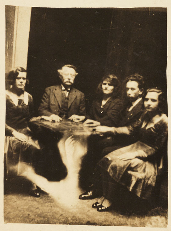 "This 1920 ""spirit photo"" by William Hope claims to show a spirit hand moving the table. (Via the National Media Museum's Flickr page)"