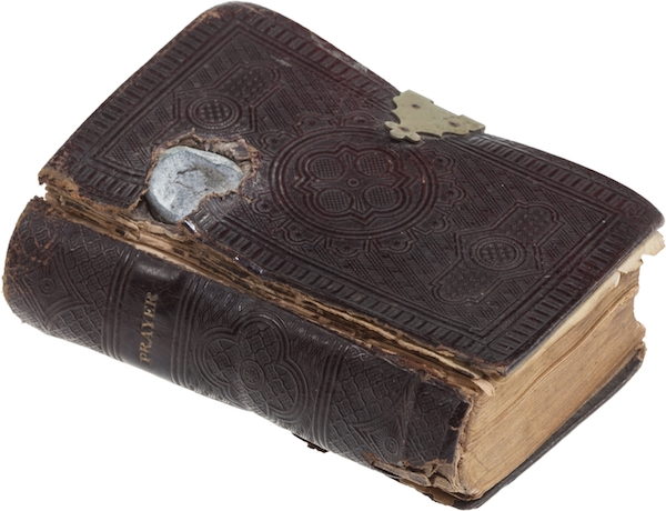 "During the Civil War, the life of Union Private Edwin C. Hall of the 10th Vermont Voluntary Infantry was almost certainly saved when this Bible intercepted a Confederate ""minie ball"" in the Battle of Sailor's Creek on April 6, 1865. (Via ""Mantiques"")"