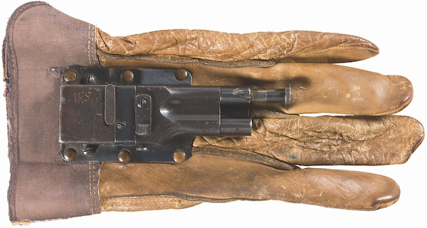 "The Sedgley Fist Gun, developed for specially trained Navy personnel in World War II, is operated when the wearer makes a fist and pushes the trigger. (Via ""Mantiques"")"