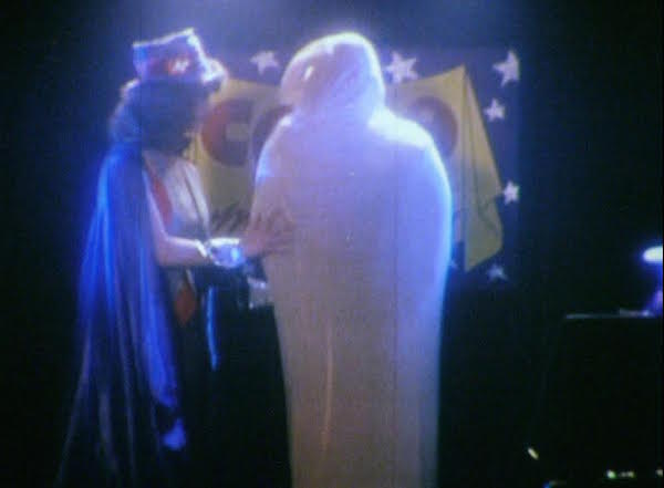"A man wears a giant condom costume in 1981's ""Condom Sense."" (Still from ""Sex(Ed): The Movie"")"