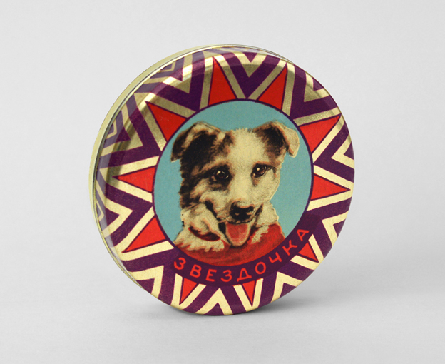 "A 1961 confectionary tin with a portrait of Zvezdochka. The text reads, ""Zvezdochka."" (© FUEL Publishing / Marianne Van den Lemmer)"