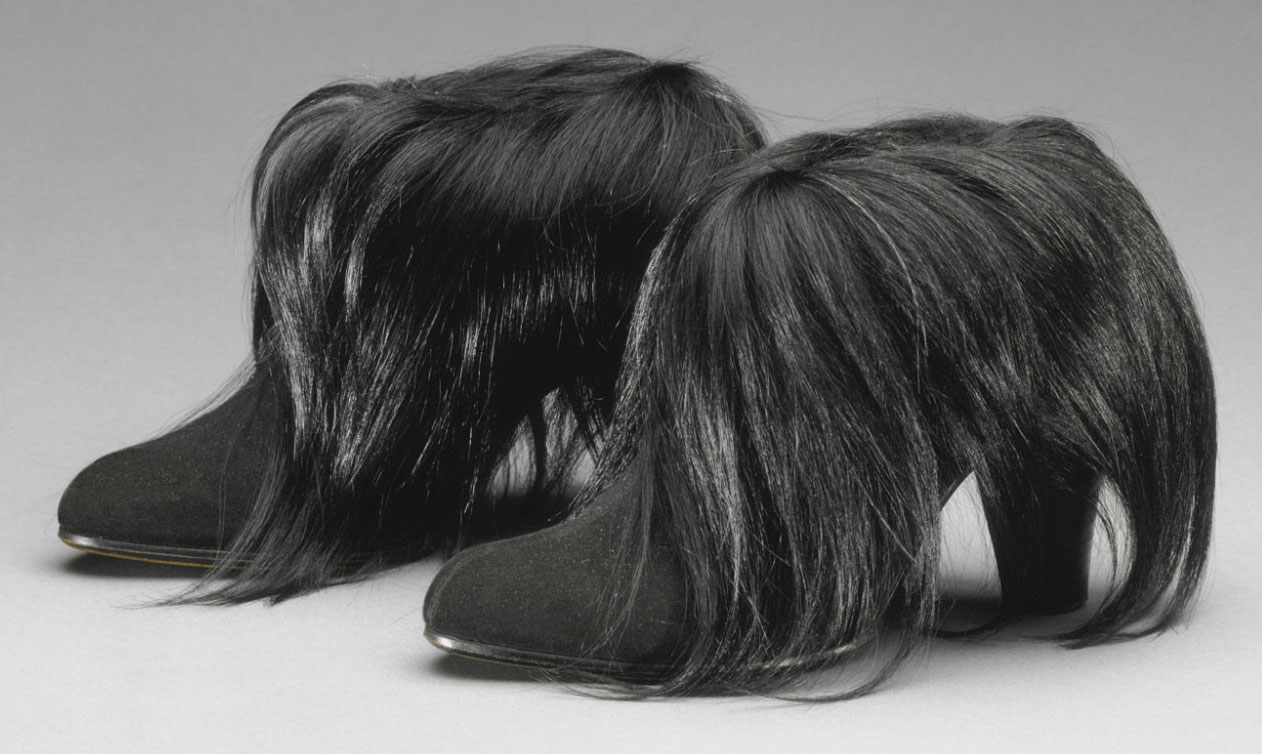 Schiaparelli topped these suede boots with monkey fur in 1938. Courtesy the  Philadelphia Museum of 04f914c13a1