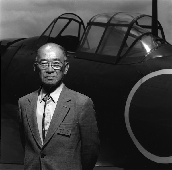 Saburo Sakai flew Mitsubishi Zeros for Japan during World War II. Photographed at Planes of Fame in front of the only airworthy Zero in North America, 1990.