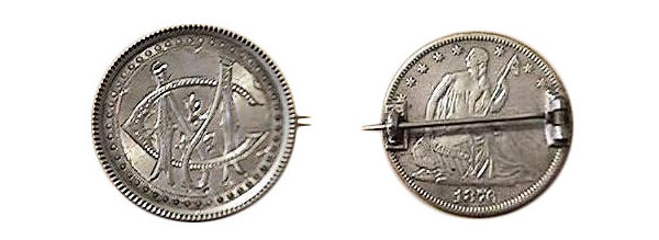 "This 1876 half dollar was carved with the initials ""MC"" and made into a pinback. (Courtesy of the Love Token Society)"