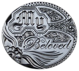 "Current-day artist Andy Gonzales engraved this ""My Beloved"" design on a 1900 Liberty nickel. (Courtesy of the Love Token Society)"