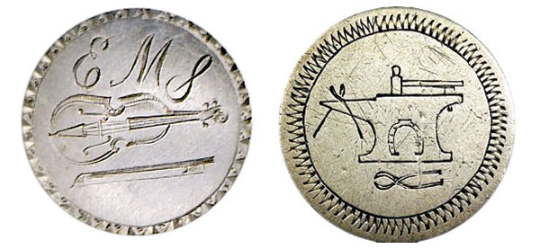 "The love token with a violin and ""EMS,"" left, was probably made for a musician, while the love token featuring an anvil and blacksmithing tools was probably made to represent a blacksmith. (Courtesy of the Love Token Society)"