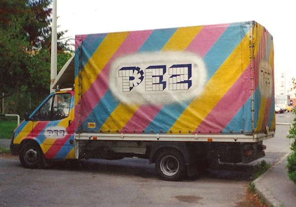 """Top: Some of the prototype Black Santas that started Steven Glew's career as the Pez Outlaw. Above, Glew and his son, Joshua, used to buy contraband Pez dispensers out of the backs of trucks like this one in Hungary and Slovenia. Both photos via <a href=""""http://www.pezoutlaw.com/"""">Pez Outlaw Diary</a>"""