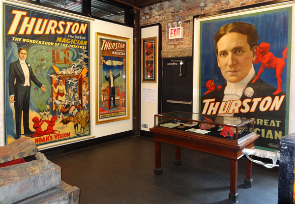 Top: Thurston levitates an assistant in a publicity still from 1930. Above: A view of the oversize Thurston posters on display at the Morbid Anatomy Museum. Images courtesy Rory Feldman.