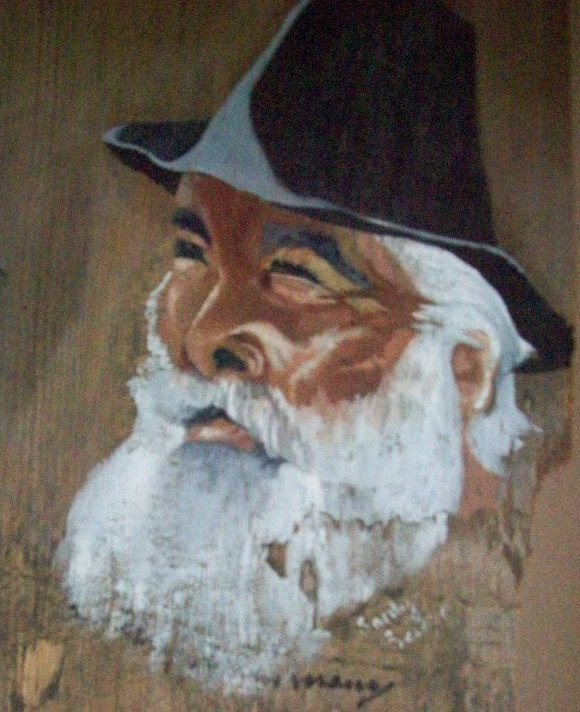 "A driftwood painting of the famous late hobo Maurice ""Steam Train Maury"" Graham in the Hobo Museum. (Via the Hobo Museum's Facebook page)"