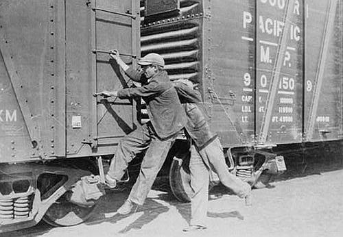 Boys hopping a freight train, circa 1925-1935. (Via Library of Congress)