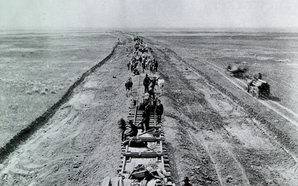 "Workers, including hoboes, lay tracks for the Transcontinental Railroad. (Via ""In Search of the American Hobo,"" from the American Studies program at the University of Virginia)"
