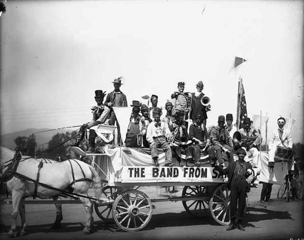 Band members wearing hobo costumes pose on a horse-drawn wagon. (From the Western History/Genealogy Department, Denver Public Library)