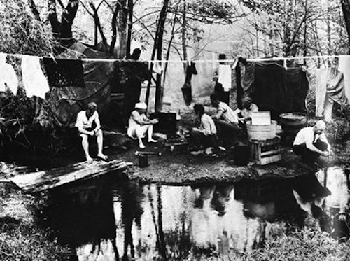 Hoboes at a jungle hang their washed laundry on a clothesline. (Via 1947project.blogspot.com)