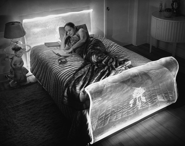 Helena Rubinstein reads by the fluorescent lighting that suffuses the head and foot of her Lucite bed, which was designed by Ladislas Medgyes in the late 1930s. (Photo by Herbert Gehr/Time Life/Getty Images, courtesy of the Jewish Museum)