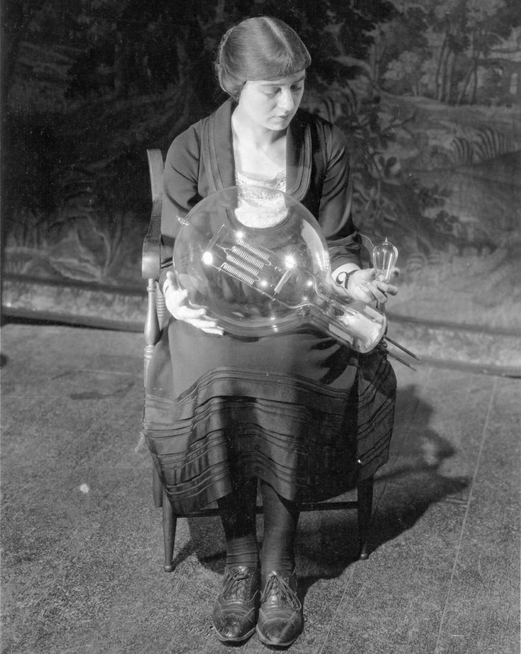 Actress Maude Adams worked with General Electric to develop improved lighting for theaters and movie sets, culminating in the creation of the world's largest incandescent bulb, at 30,000 watts, which she compares with a standard 25-watt bulb, circa 1921.