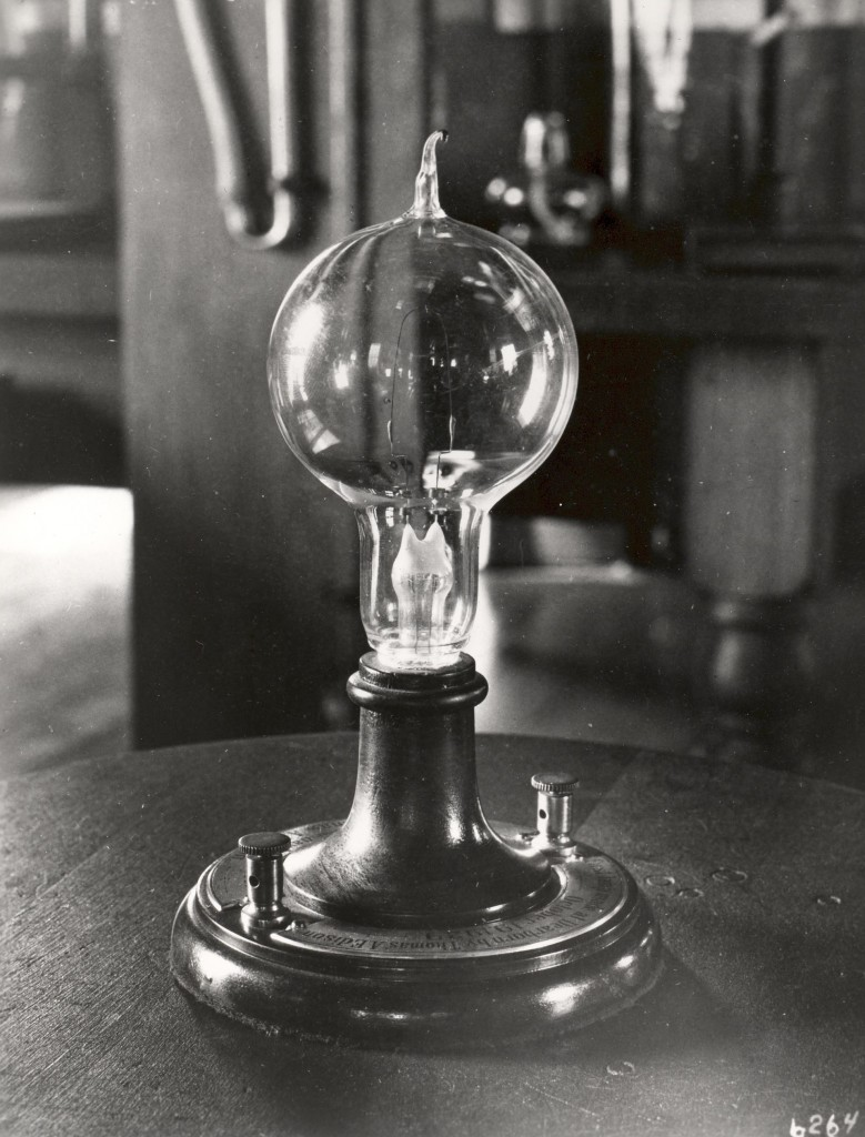 Top: A 1909 advertisement for General Electric's Mazda light bulbs, which were based on Edison's designs. Above: A 1929 replica of Edison's incandescent prototypes from the early 1880s.