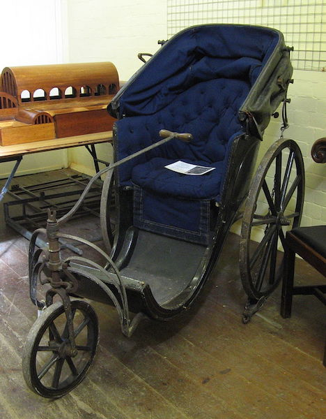 "Top: An 1844 portrait of Oliver Caswell and Laura Bridgman, the first blind and deaf person educated at the Perkins Institute for the Blind in Massachusetts. (Via Nineteenth-Century Disability, courtesy of the Wellcome Library) Above: An early wheelchair, known as a ""Bath chair,"" at the St John's Museum Store, Bath. (Via WikiCommons)"