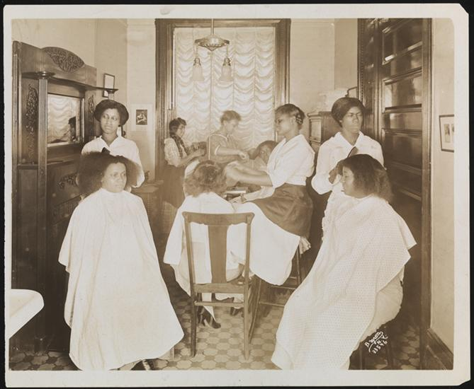 Women have their hair done at Madam Walker's salon in Harlem. Via the Museum of the City of New York.