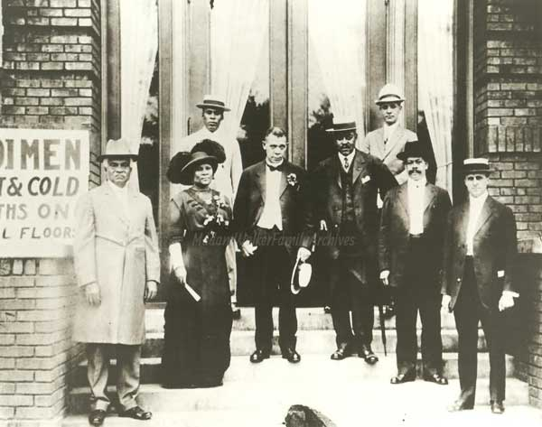 "From left, George Knox (publisher of the ""Indianapolis Freeman""), Madam Walker, Booker T. Washington, and members of the YMCA Board at the building's dedication in 1913. Image ©<a href=""http://www.madamcjwalker.com/"">Madam Walker Family Archives</a>/A'Lelia Bundles."