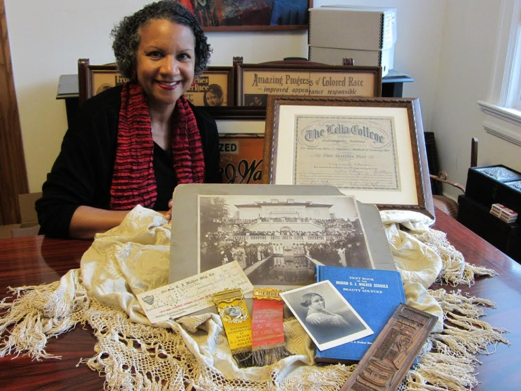 Madam Walker's great-great-granddaughter, A'Lelia Bundles, with a few artifacts from her collection. Image