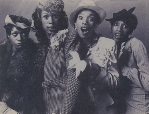 The Pointer Sisters—Bonnie, Ruth, Anita, and June—play around in vintage clothes in the 1970s. (Via ThePointerSisters.com)