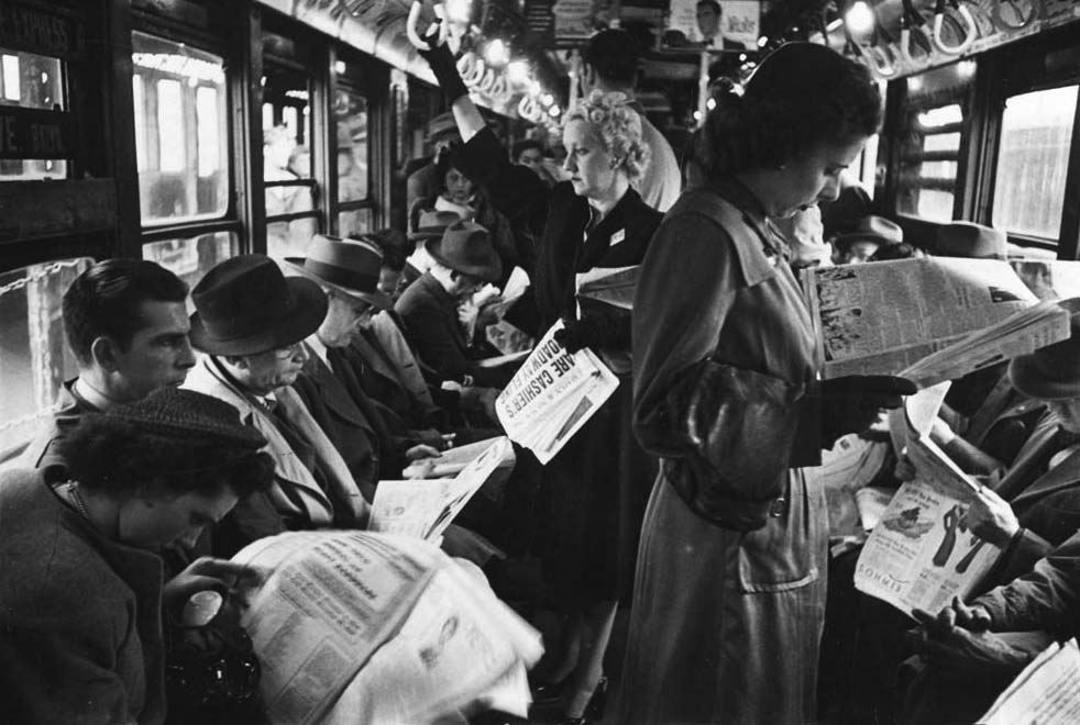 "Top: A French postcard from around 1900 predicts videophone technology of the year 2000. Above: Before cell phones, humans had plenty of other media to distract them during the daily commute. This photo of passengers reading in a subway car was taken by Stanley Kubrick in 1946. Via the <a href=""http://blog.mcny.org/2012/04/24/a-ride-on-the-subway-in-1946-with-stanley-kubrick/"">Museum of the City of New York</a>."