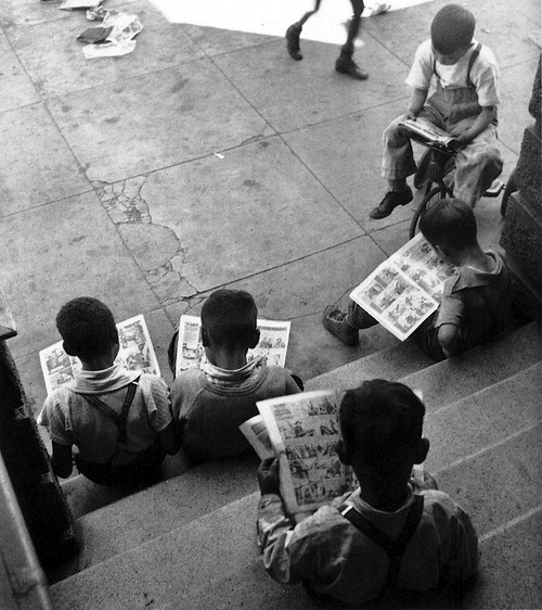 "Children suffering from an unhealthy, anti-social ""comic addiction,"" seen in a 1938 photo by <a href=""http://johngutmann.org/"">John Gutmann</a>."