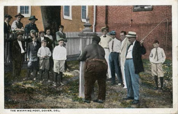 """The hand-written message on the back of this postcard, dated 1924, says """"This picture shows what they do to the bad people of Del."""" (From """"Understanding Jim Crow"""")"""