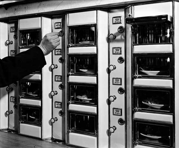 "A customer makes his selection in this 1936 photo by Berenice Abbott. Via the <a href=""http://digitalcollections.nypl.org/collections/robert-f-byrnes-collection-of-automat-memorabilia#/?tab=navigation"">New York Public Library</a>."