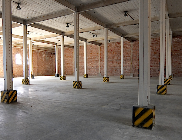 The inside of Building One features concrete floors and ceilings, with heavy steel framing throughout.