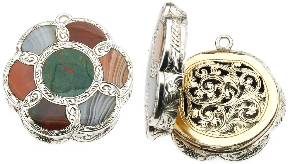 An agate-topped silver vinaigrette with an engraved interior grill, circa 1857.