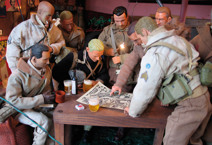 When Marwencol is under siege by Nazi SS officers, the village's men gather at Hogancamp's Ruined Stocking Catfight Club to strategize using a map drawn by Mark Hogancamp. (Photo by Hogancamp, courtesy of Princeton Architectural Press)