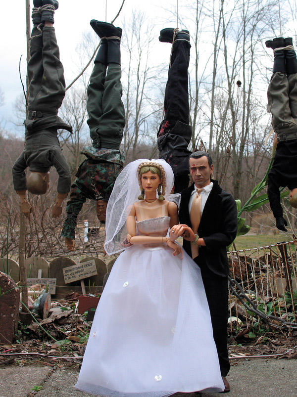Hogie and Anna get married with the bodies of the five SS officers strung up behind them. (Photo by Mark Hogancamp, courtesy of Princeton Architectural Press)