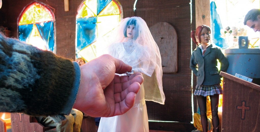 Deja Thoris, the Belgian Witch of Marwencol, marries the Giant of Marwencol, a.k.a. human Mark Hogancamp, at the village church. (Photo by Hogancamp, courtesy of Princeton Architectural Press)