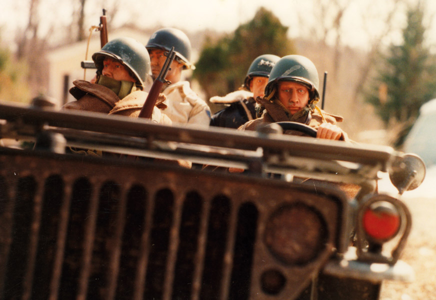 "Top: Mark Hogancamp and his alter ego, Hogie, pose with their cameras. Above: ""Patton and the Jeep"" is one of Mark Hogancamp's earliest Marwencol photos, taken circa 2004 with a 35mm film camera. (Photos by Hogancamp, courtesy of Princeton Architectural Press)"