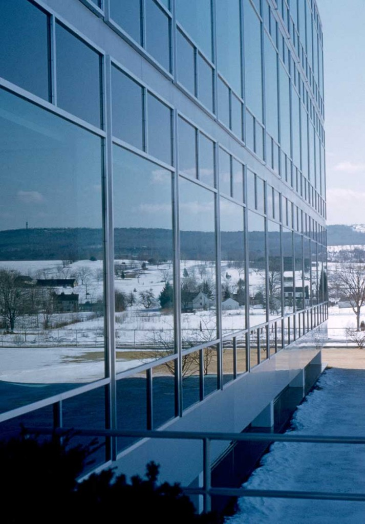 "A glass facade reflects the rural surroundings of Connecticut General's new Bloomfield office, circa 1950s. Via <a href=""https://dome.mit.edu/handle/1721.3/29817"">MIT Libraries</a>."